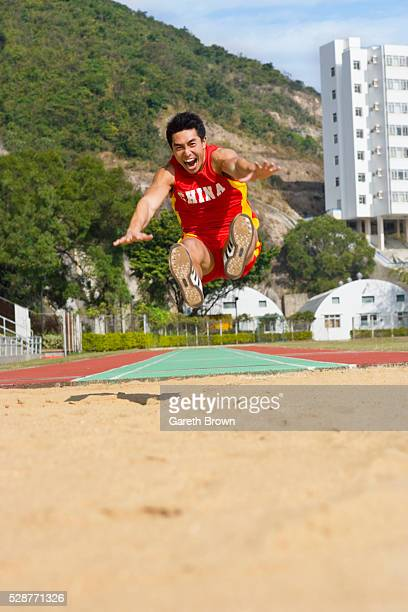 long jumper in air - extra long ストックフォトと画像