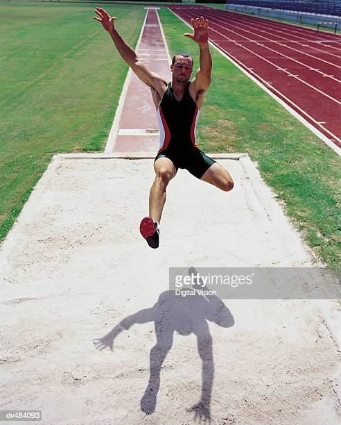 Long jumper in mid-air
