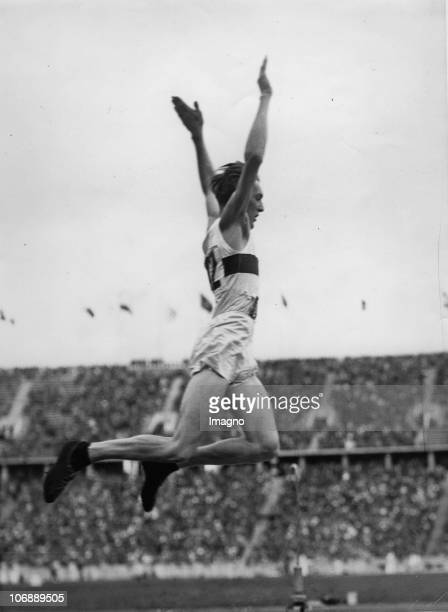 Long jumping Carl Ludwig Long at the Olympic Games Berlin Germany Photograph August 4 1936