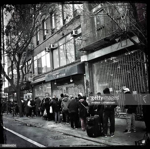 A long line curves around the block on Thanksgiving morning outside the Bowery Mission for the free holiday meal being offered to thousands