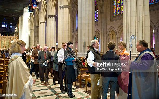 A long line forms at the National Cathedral to greet the new Episocal Bishop Mariann Budde second from right after services Sunday November 13 2011...