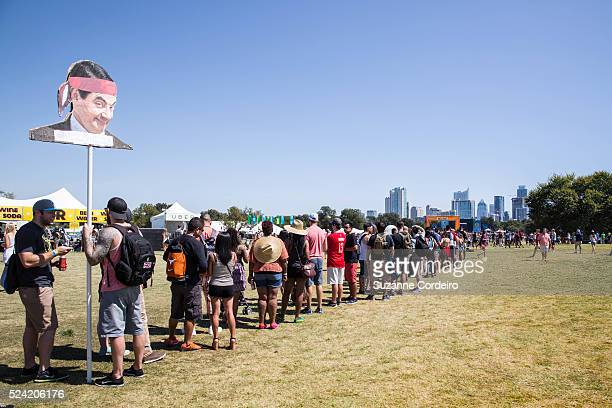 A long line is formed by festgoers waiting for their picture to be taken on the frame on top of a hill at Zilker Park during ACL Music Festival on...