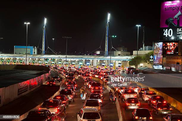 Long line of cars crossing Mexican border at Tijuana/San Ysidro