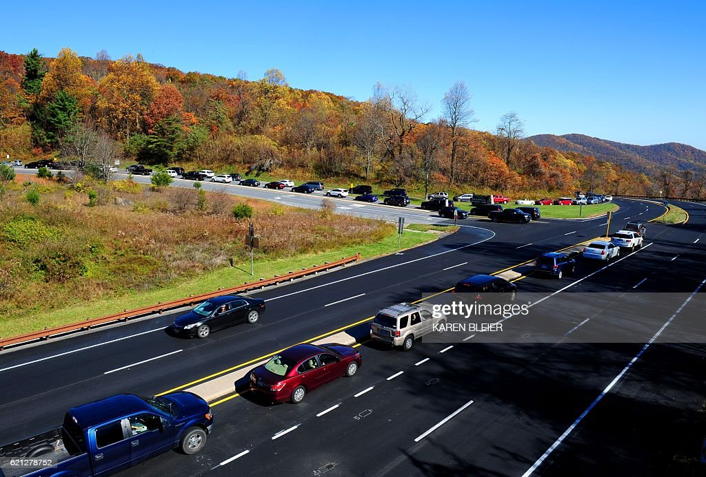 A long line of cars wait to enter Skyline Drive in the Shenandoah ...