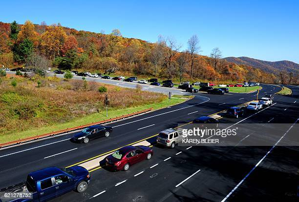 A long line of cars wait to enter Skyline Drive in the Shenandoah National Park in Virginia November 5 2016 Many hundreds of people came out to enjoy...