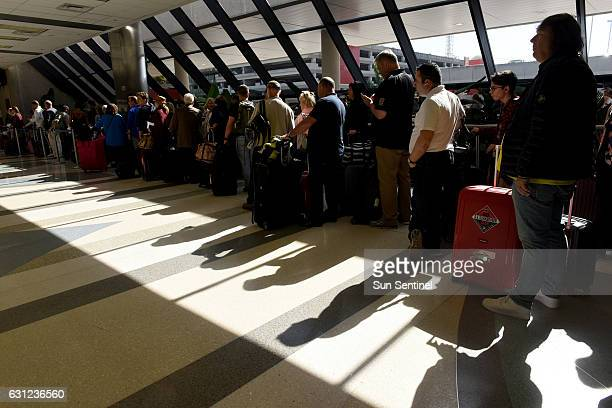 A long line of Delta passengers wait to check in at the Terminal 2 ticket counter on Sunday morning Jan 8 2017 at Fort LauderdaleHollywood...