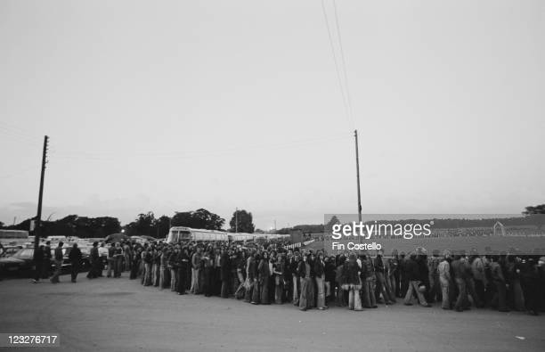 A long line of fans as they queue to see Canadian rock band Rush in concert at Bingley Hall in Stafford Staffordshire England United Kingdom 21...