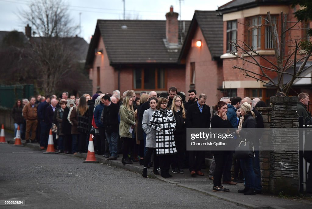 A long line of mourners queue to pay ther respects at the home of Martin McGuinness on March 22, 2017 in Londonderry, Northern Ireland. Northern Ireland's Former Deputy First Minister Martin McGuinness died overnight on Monday 20th March 2017. He was once chief of staff of the IRA and became Sinn Fein's chief negotiator in the talks that led to the Good Friday agreement bringing peace to Northern Ireland.