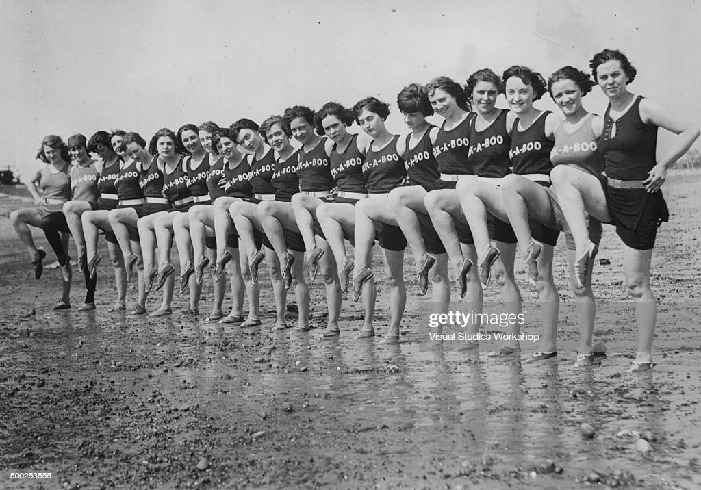 A long line of Peek-a-boo girls show off their moves on Revere Beach, Revere, Massachusetts, early to mid 20th century.