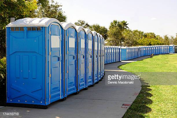 long line of portable toilets - portable toilet stock photos and pictures
