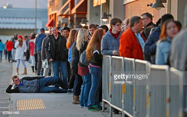 A long line of shoppers wait for the Best Buy to open for 'Black Friday' deals on November 24 2016 in Orem Utah Retailers kicked off the unofficial...