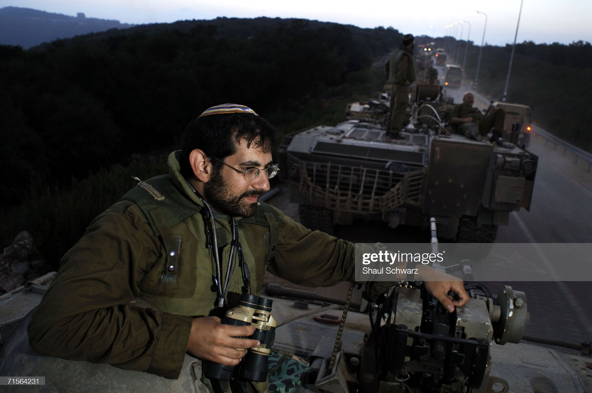https://media.gettyimages.com/photos/long-line-of-tanks-and-armed-personal-carriers-are-parked-as-israeli-picture-id71564231?s=2048x2048