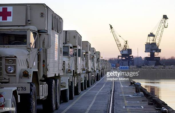 A long line of US Army ambulances fill the Ocean Terminal dock January 14 2003 at the Port of Savannah Georgia Hundreds of vehicles were being...