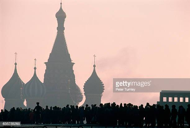 A long line of visitors wait in Red Square to see Lenin's Tomb