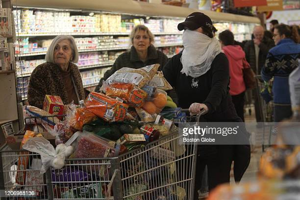 Long lines form at the Market Basket in Waltham MA on March 13 2020 as citizens stock up amid growing coronavirus cases