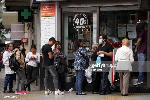 Long lines in pharmacies to buy chinstraps and gel alcohol to prevent the spread of COVID19 in Buenos Aires Argentina on March 18 2020
