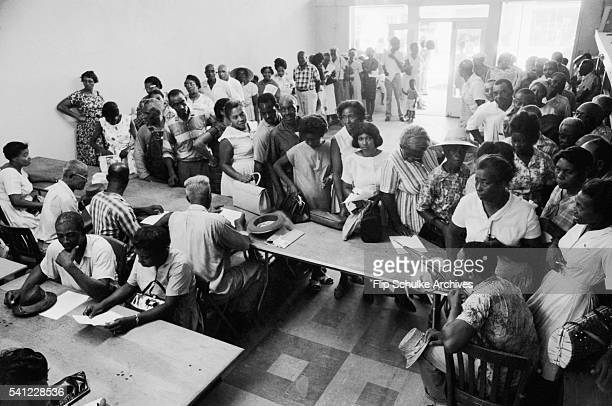 Long lines of African Americans wait to register to vote in a makeshift office in Alabama after passage of the Voting Rights Act.