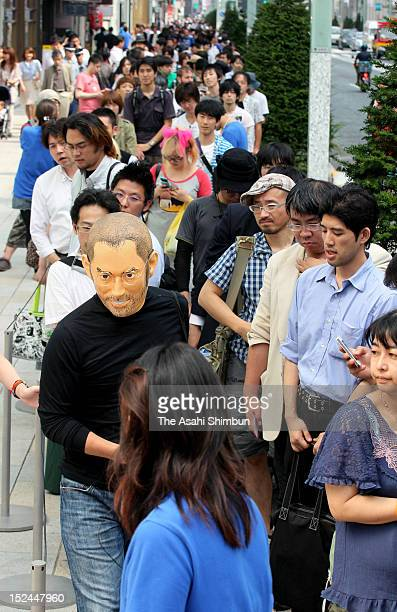 Long lines of customers wait to purchase the new iPhone 5 on the launch day on September 21 2012 in Tokyo Japan