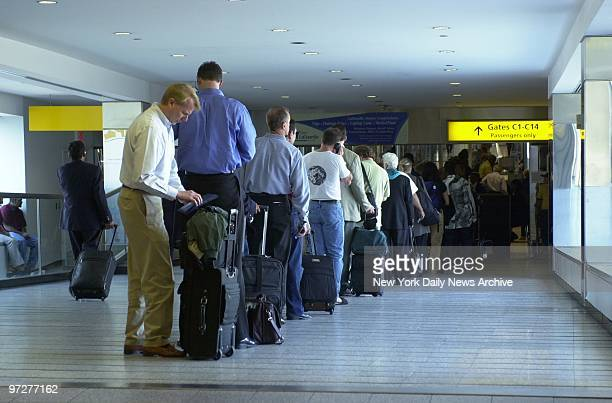 Long lines of people wait at LaGuardia Airport to pass through the carryon baggage scanners and metal detectors reflecting the increased precautions...