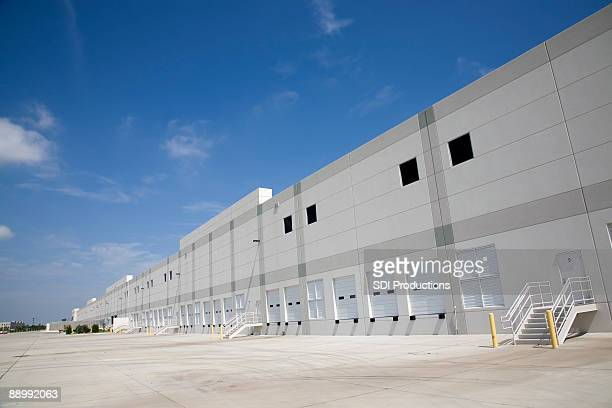 long loading dock bays - irving texas stock photos and pictures