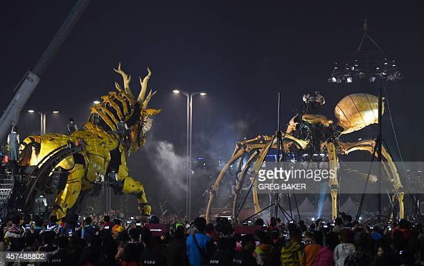 A Long Ma a Frenchmade giant dragon horse faces off with a mechanical spider during a performance at the Bird's Nest National Stadium in Beijing on...