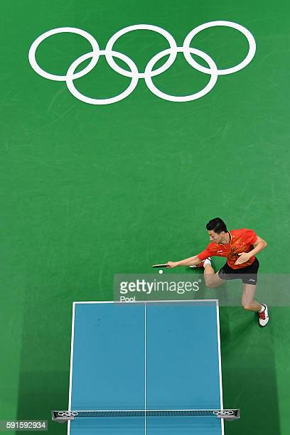 Long Ma of China and Koki Niwa of Japan compete during the Men's Table Tennis gold medal match at Riocentro Pavilion 3 on Day 12 of the Rio 2016...