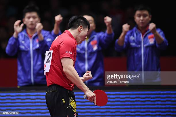 Long Ma of China celebrates a point against Timo Boll of Germany during day eight of the 2014 World Team Table Tennis Championships at Yoyogi...