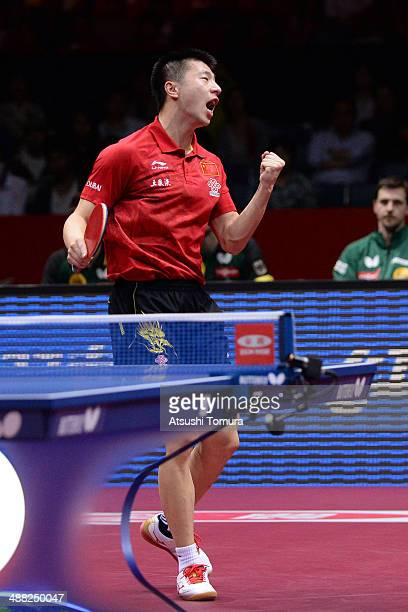 Long Ma of China celebrates after winning the match against Dimitrij Ovtcharov of Germany during day eight of the 2014 World Team Table Tennis...