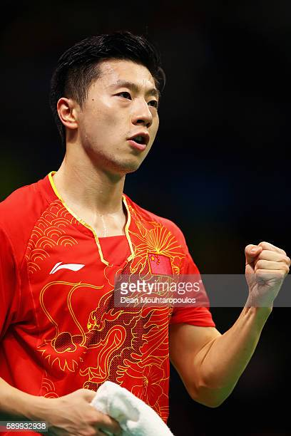 Long Ma of China celebrates victory against Saehyuk Joo of South Korea during the Table Tennis Men's Team Round Semi Final between China and South...