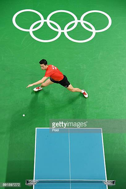 Long Ma of China competes during the Men's Table Tennis gold medal match against Koki Niwa of Japan at Riocentro - Pavilion 3 on Day 12 of the Rio...