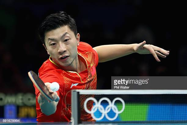 Long Ma of China competes during the Men's Table Tennis gold medal match against Maharu Yoshimura of Japan at Riocentro - Pavilion 3 on Day 12 of the...