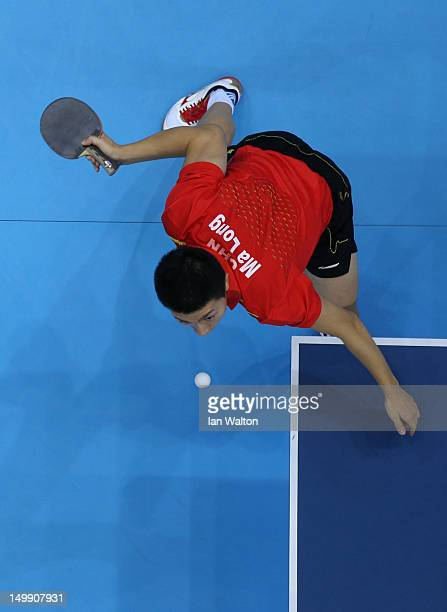 Long Ma of China in action against Dimitrij Ovtcharov of Germany during the men's team table tennis semifinals on Day 10 of the London 2012 Olympic...