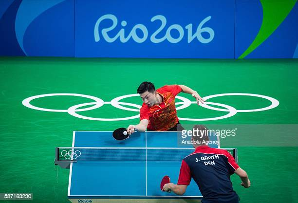 Long Ma of China in action against Jonathan Groth of Denmark during men's singles third round match on second day of the Rio 2016 Olympic Games at...