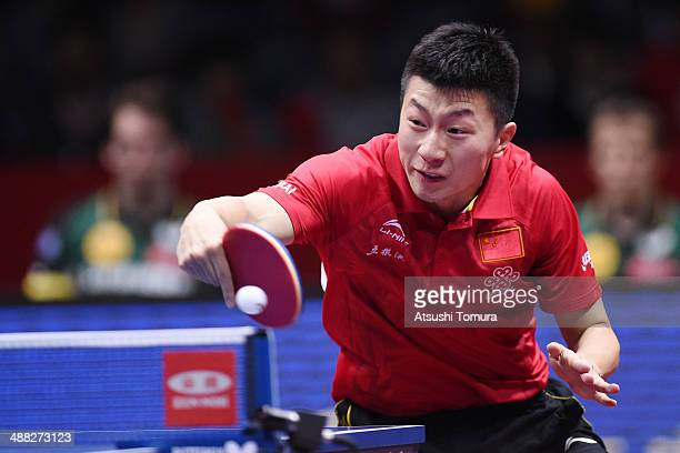Long Ma of China plays a backhand against Timo Boll of Germany during day eight of the 2014 World Team Table Tennis Championships at Yoyogi National...