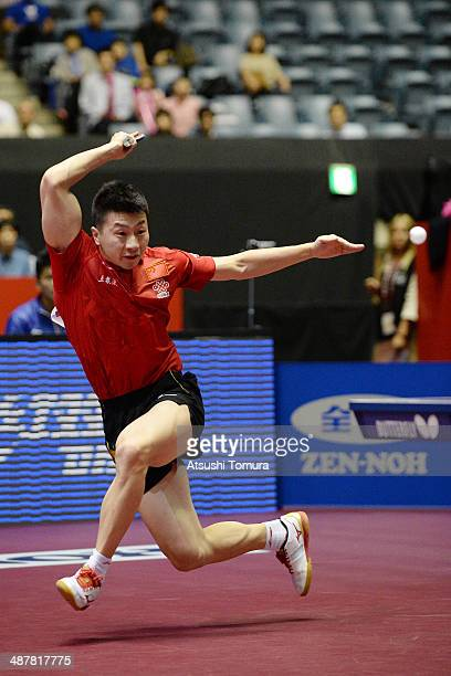 Long Ma of China plays a forehand against Daniel Habesohn of Austria during day five of the 2014 World Team Table Tennis Championships at Yoyogi...