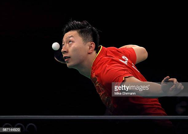 Long Ma of China plays a Men's Singles third round match against Jonathan Groth of Denmark on Day 2 of the Rio 2016 Olympic Games at Riocentro...