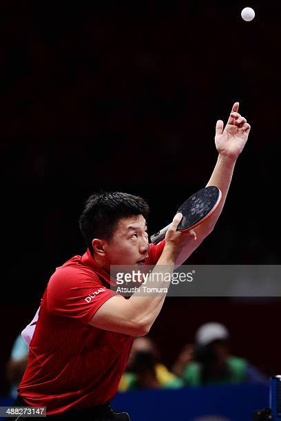 Long Ma of China serves against Dimitrij Ovtcharov of Germany during day eight of the 2014 World Team Table Tennis Championships at Yoyogi National...