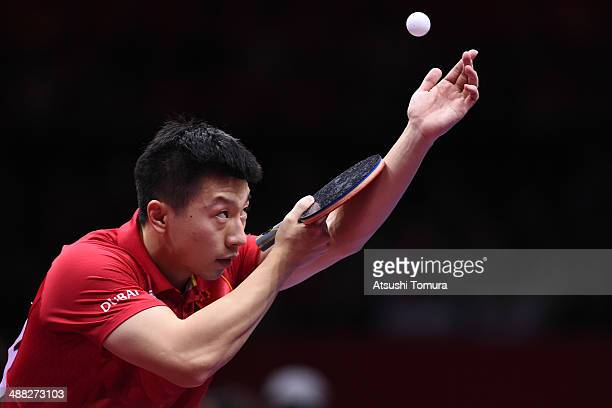 Long Ma of China serves against Timo Boll of Germany during day eight of the 2014 World Team Table Tennis Championships at Yoyogi National Gymnasium...