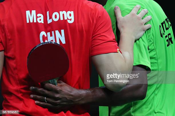 Long Ma of China takes on Aruna Quadri of Nigeria during the Men's Singles Quarterfinal 2 Table Tennis on Day 4 of the Rio 2016 Olympic Games at the...