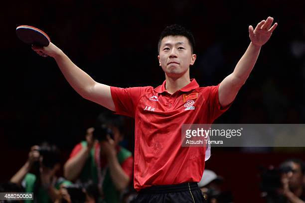 Long Maand of China celebrates after he wins the match against Dimitrij Ovtcharov of Germany during day eight of the 2014 World Team Table Tennis...