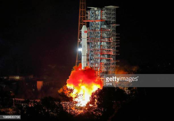 A Long March 3B rocket lifts off from the Xichang launch centre in Xichang in China's southwestern Sichuan province early on December 8 2018 China...