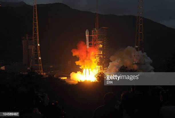 A Long March 3C rocket carrying the Chang'e2 probe which will go into orbit within 15 kilometres of the moon blasts off from the launch centre in...
