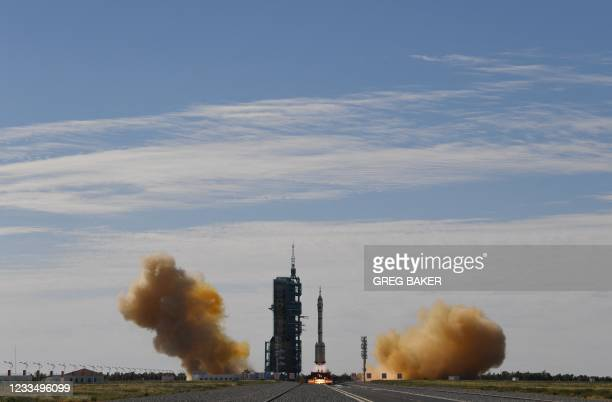 Long March-2F carrier rocket, carrying the Shenzhou-12 spacecraft and a crew of three astronauts, lifts off from the Jiuquan Satellite Launch Centre...