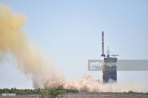 A Long March4B rocket carrying a 25tonne telescope lifts off from the Jiuquan Satellite Launch Center in northwest China's Gobi Desert on June 15...