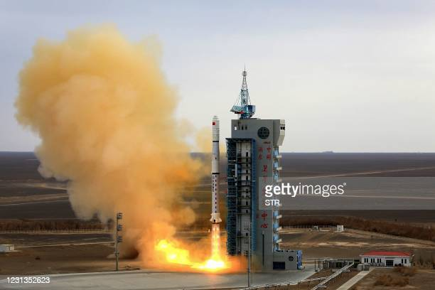Long March-4C rocket carrying the third group of China's Yaogan-31 remote sensing satellites lifts off from the Jiuquan Satellite Launch Center in...