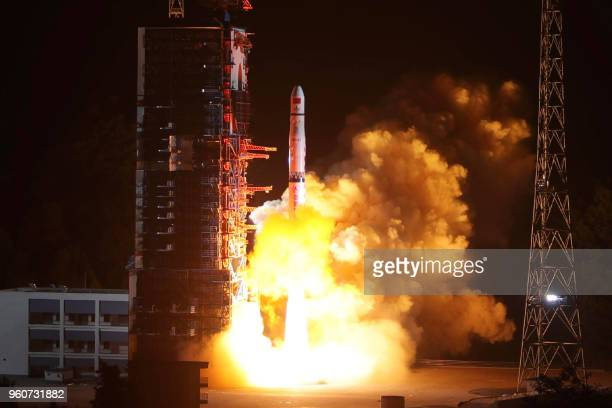 Long March4C rocket lifts off from the southwestern Xichang launch centre carrying the Queqiao satellite in Xichang China's southwestern Sichuan...