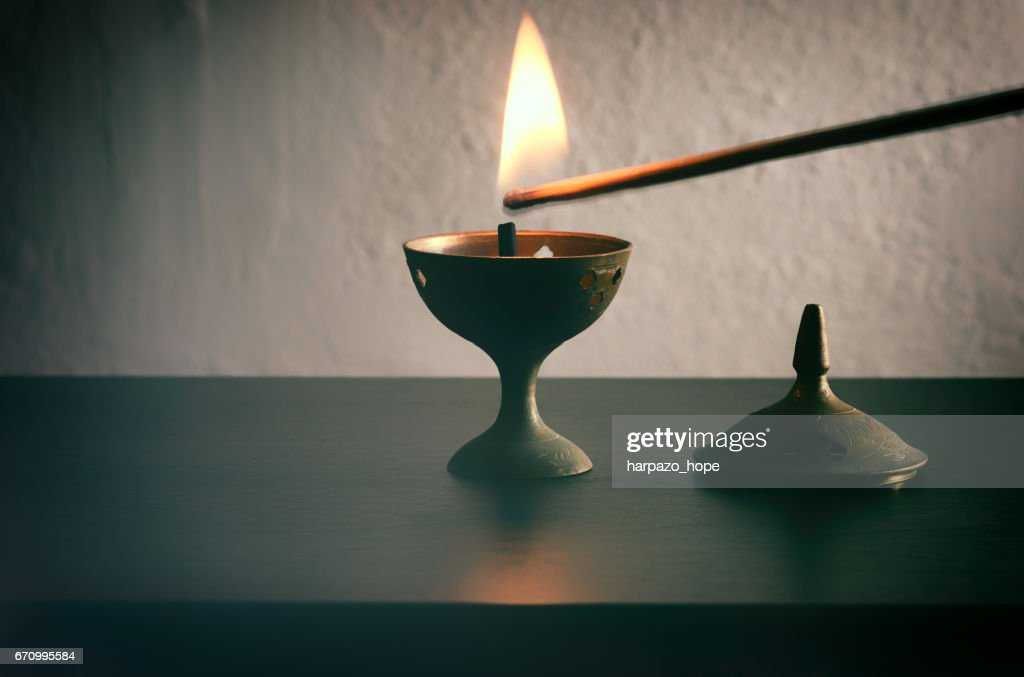 Long match lighting an incense cone. : Foto de stock