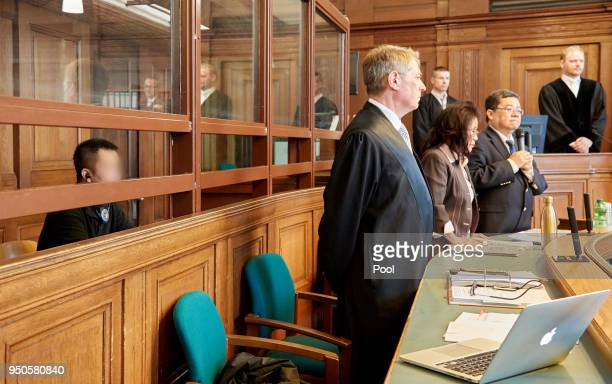 Long N H appears for his trial on charges of espionage and kidnapping at the Kammergericht Moabit courthouse on April 24 2018 in Berlin Germany...