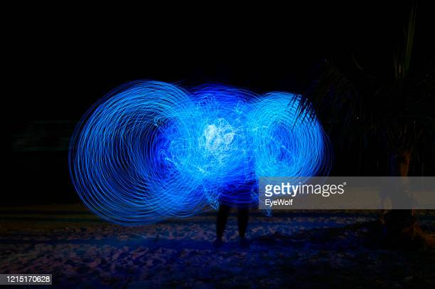 long night exposure of blue neon lights. - royal blue stock pictures, royalty-free photos & images