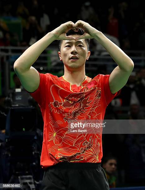 Long of China celebrates after winning the Mens Table Tennis Gold Medal match between Ma Long of China and Zhang Jike of China at Rio Centro on...